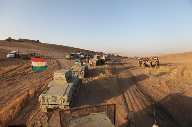 Military vehicles of the Kurdish Peshmerga forces are seen on the southeast of Mosul, Iraq, August 14, 2016. REUTERS/Azad Lashkari - RTX2KS36