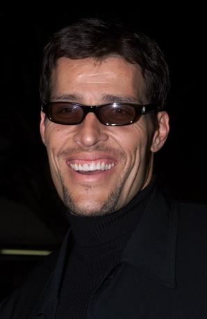 FILE PHOTO: Motivational speaker Tony Robbins arrives as a guest for the premiere of the new action film '' Get Carter'' October 4, 2000 in Los Angeles. In the film Sylvester Stallone portrays a collection agent in Las Vegas who sets out to avenge his brother killing. REUTERS