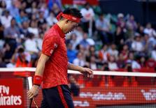 Tennis - Japan Open men's Singles Round 1 match - Ariake Coliseum, Tokyo, Japan - 05/10/16. Kei Nishikori of Japan walks out of a court as he retires during a match against Joao Sousa of Portugal. REUTERS/Kim Kyung-Hoon