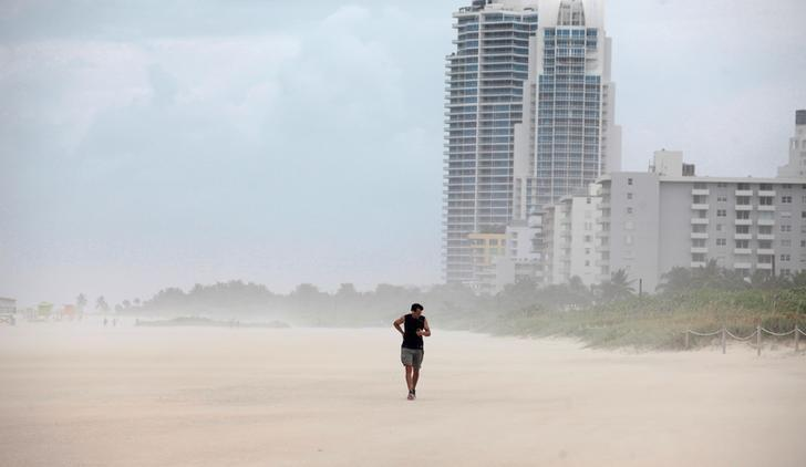 A person walks along the beach prior to the arrival of Hurricane Matthew in Miami Beach, Florida, U.S. October 6, 2016. REUTERS/Javier Galeano