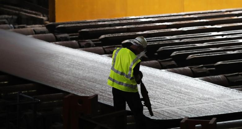 Steel is seen in the rolling mill following the  recommissioning of the works by Liberty Steel Group at the Dalzell steel plant in Motherwell, Britain September 28, 2016. REUTERS/Russell Cheyne