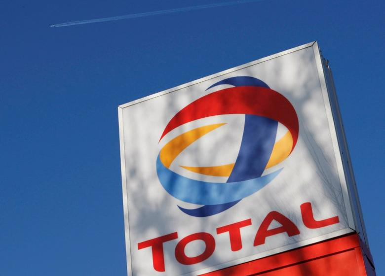 A logo for oil giant Total is seen at a petrol station in London February 12, 2008.    REUTERS/Stephen Hird/File Photo