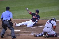 Oct 7, 2016; Cleveland, OH, USA; Cleveland Indians left fielder Brandon Guyer (6) scores against Boston Red Sox catcher Sandy Leon (3) on a sacrifice fly by Indians center fielder Rajai Davis (not pictured) in the sixth inning in game two of the 2016 ALDS playoff baseball series at Progressive Field. Mandatory Credit: David Richard-USA TODAY Sports