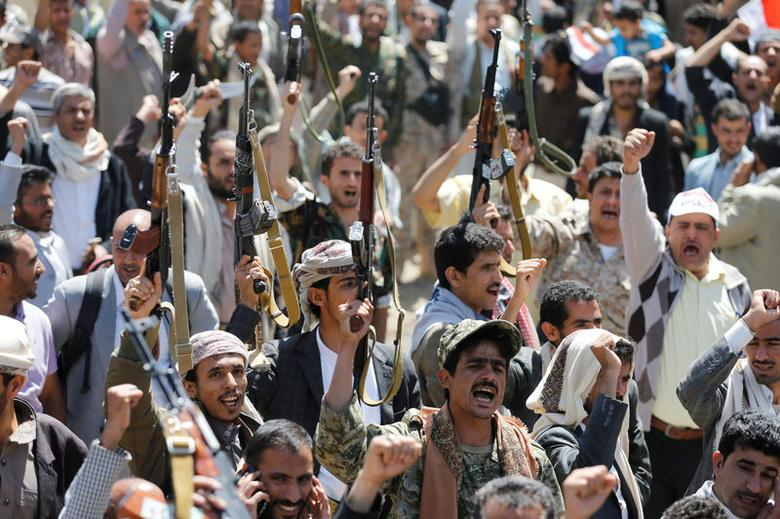 Armed people demonstrate outside the United Nations offices against Saudi-led air strikes on funeral hall in Sanaa, the capital of Yemen, October 9, 2016. REUTERS/Khaled Abdullah