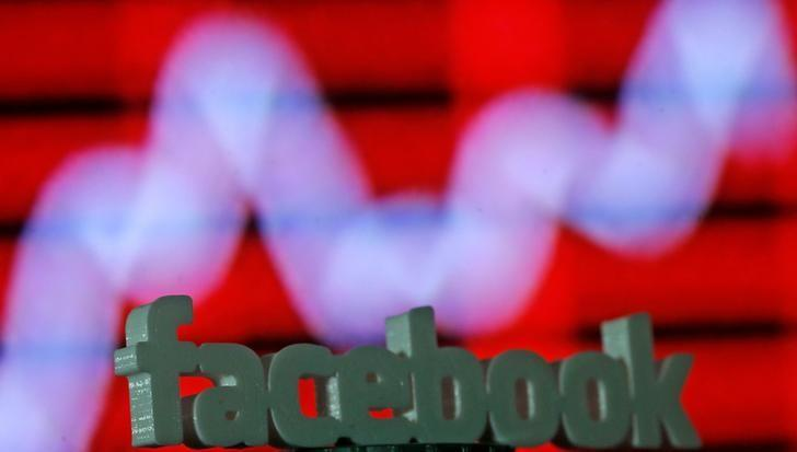 A 3D printed Facebook logo is seen in front of a displayed stock graph in this illustration taken April 28, 2016. REUTERS/Dado Ruvic/Illustration