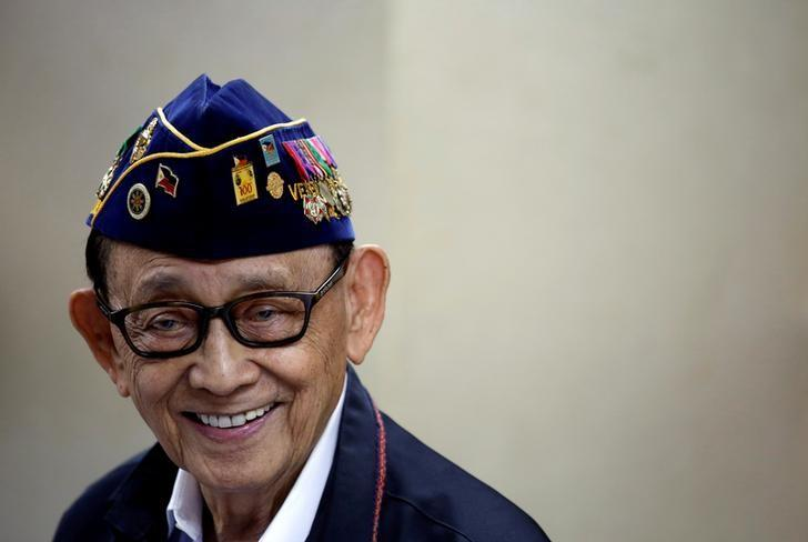 Former Philippine President Fidel Ramos reacts as he speaks to journalists during a trip to Hong Kong, China, after a Hague court's ruling over the maritime dispute in South China Sea, August 12, 2016. Picture taken August 12, 2016.        REUTERS/Tyrone Siu/File Photo
