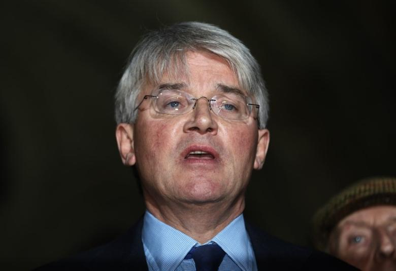 Andrew Mitchell, Britain's former Conservative Party chief whip, speaks outside the Royal Courts of Justice in London, November 27, 2014.   REUTERS/Luke MacGregor