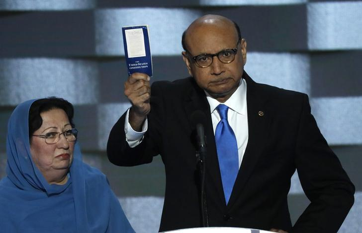 Khizr Khan, whose son, Humayun S. M. Khan was one of 14 American Muslims who died serving in the U.S. Army  in the 10 years after the 9/11 attacks, offers to loan his copy of the Constitution to Republican U.S. presidential nominee Donald Trump, as he speaks while a relative looks on during the last night of the Democratic National Convention in Philadelphia, Pennsylvania, U.S. July 28, 2016. REUTERS/Mike Segar/Files