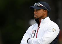 Team USA vice-captain Tiger Woods talk at the 13th green during the practice round for the Ryder Cup at Hazeltine National Golf Club in Chaska, Minnesota, September 28, 2016.  Mandatory Credit: Michael Madrid-USA TODAY Sports/File photo