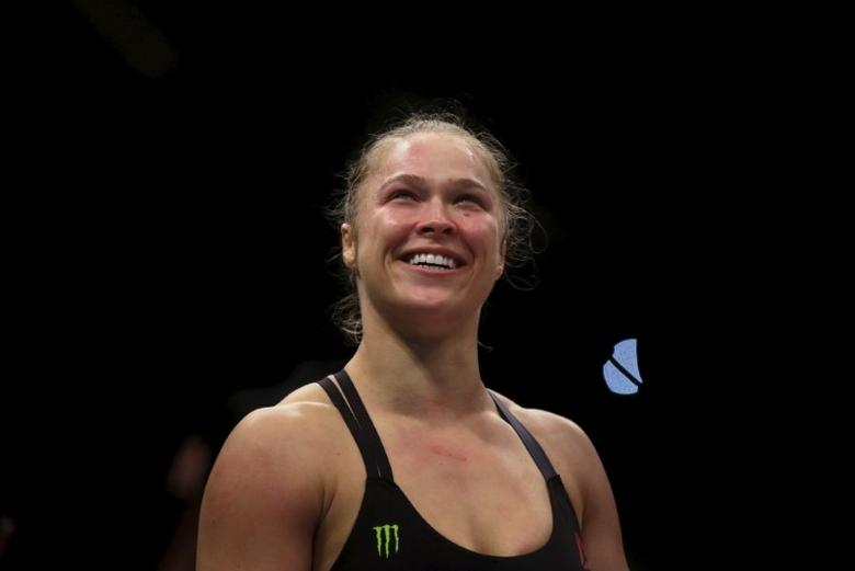 Ronda Rousey (R) of U.S celebrates after defeating Bethe Correia of Brazil during their Ultimate Fighting Championship (UFC) match, a professional mixed martial arts (MMA) competition in Rio de Janeiro, Brazil August 1, 2015. REUTERS/Ricardo Moraes