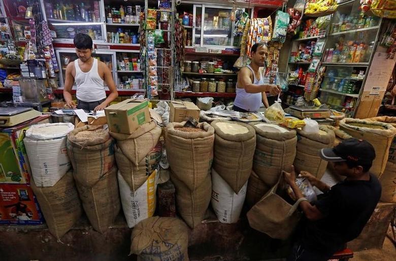 A shopkeeper sells groceries to a customer at his shop in Kolkata, India, September 12, 2016. REUTERS/Rupak De Chowdhuri/Files