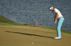 May 14, 2016; Ponte Vedra Beach, FL, USA; Ian Poulter putts on the 18th green during the third round of the 2016 Players Championship golf tournament at TPC Sawgrass - Stadium Course.  John David Mercer-USA TODAY Sports