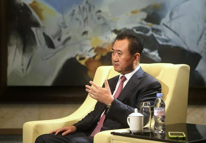 Wang Jianlin, chairman of Chinese property developer Dalian Wanda Group, answers a question during a Reuters interview in Qingdao, Shandong province, September 22, 2013.  REUTERS/Jason Lee