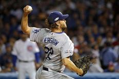 Oct 16, 2016; Chicago, IL, USA; Los Angeles Dodgers starting pitcher Clayton Kershaw (22) pitches during the fifth inning against the Chicago Cubs in game two of the 2016 NLCS playoff baseball series at Wrigley Field. Mandatory Credit: Jon Durr-USA TODAY Sports
