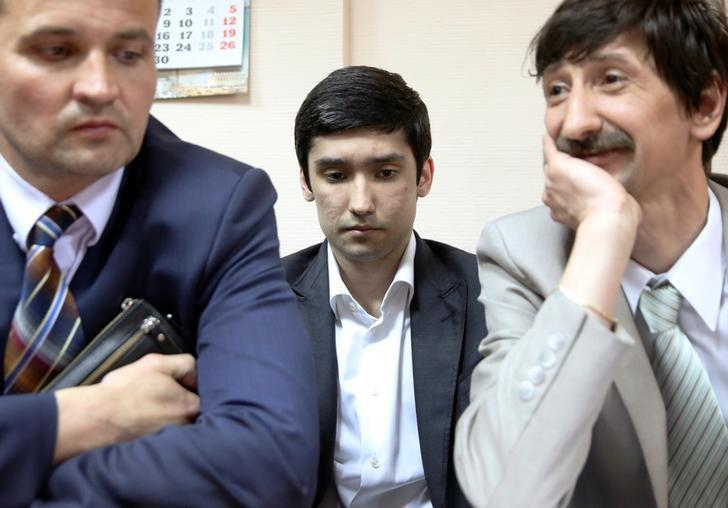 Ruslan Shamsuarov (C), the son of a senior Lukoil executive, and his attorneys attend a court hearing in Moscow, Russia, May 28, 2016. REUTERS/Stringer/Files