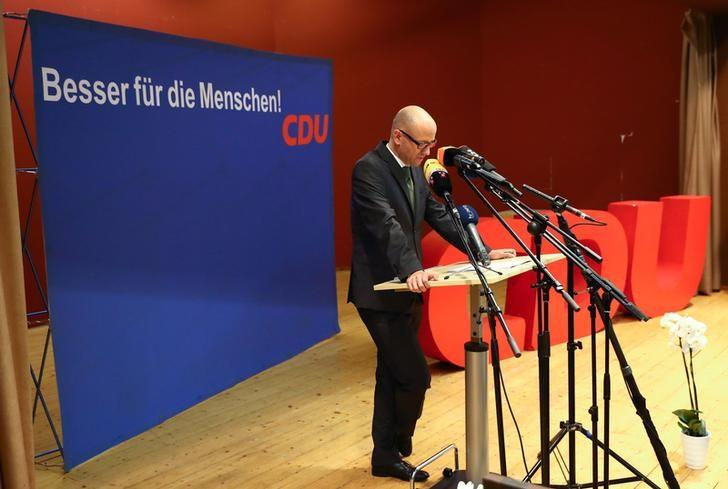 Peter Tauber, secretary general of Germany's Christian Democratic Union (CDU) delivers his speech at a local party meeting in Niederissigheim near Frankfurt, Germany, September 30, 2016. The slogan in the back reads ''better for the people''.  REUTERS/Kai Pfaffenbach