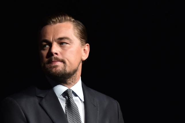 U.S. actor Leonardo DiCaprio looks on prior to speaking on stage during the Paris premiere of the documentary film ''Before the Flood'' on October 17, 2016 at the Theatre du Chatelet in Paris, France.    REUTERS/Christophe Archambault/Pool