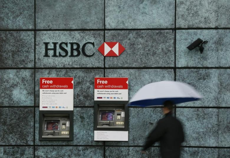 A man walks past a HSBC bank branch in the City of London, Britain November 12, 2014.   REUTERS/Stefan Wermuth/File Photo