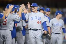 Oct 19, 2016; Los Angeles, CA, USA; Chicago Cubs first baseman Anthony Rizzo (44) celebrates with teammates after game four of the 2016 NLCS playoff baseball series against the Los Angeles Dodgers at Dodger Stadium. Mandatory Credit: Gary A. Vasquez-USA TODAY Sports