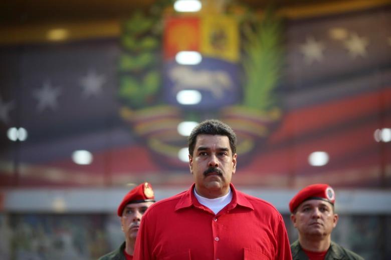 Venezuela's President Nicolas Maduro receives military honors at Maiquetia airport, in Caracas, Venezuela October 20, 2016. Miraflores Palace/Handout via REUTERS