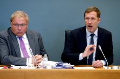 Minister-President of Wallonia Paul Magnette answers deputies' questions next to Andre Antoine (L), president of the Walloon regional parliament, during a debate on the Comprehensive Economic and Trade Agreement (CETA), a planned EU-Canada free trade agreement, at the Walloon regional parliament in Namur, Belgium October 21, 2016. REUTERS/Francois Lenoir - RTX2PUUO