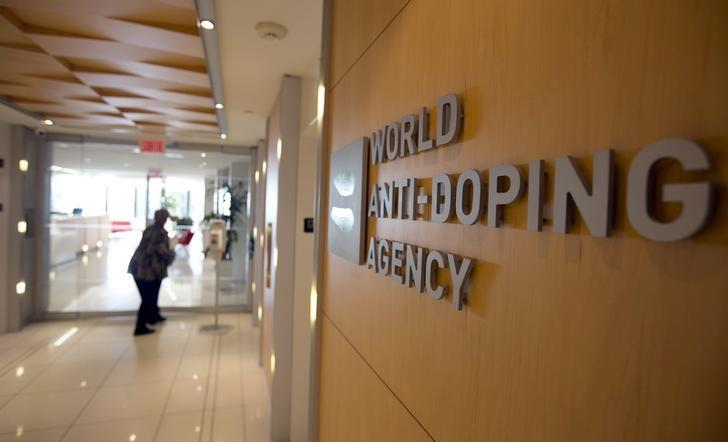 A woman walks into the head office of the World Anti-Doping Agency (WADA) in Montreal, Quebec, Canada November 9, 2015.  REUTERS/Christinne Muschi/File Photo  - RTSO0J6
