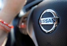 A logo of Nissan Motor Co is seen on a steering wheel as a woman drives her car in Golfech, southwestern France, April 23, 2016. REUTERS/Regis Duvignau