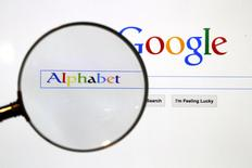 A Google search page is seen through a magnifying glass in this photo illustration taken in Berlin, August 11, 2015.  REUTERS/Pawel Kopczynski/File Photo