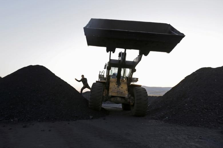 A driver gets off a loading vehicle at local businessman Sun Meng's small coal depot near a coal mine of the state-owned Longmay Group on the outskirts of Jixi, in Heilongjiang province, China, October 23, 2015.  REUTERS/Jason Lee/File Photo  - RTX2RGUI