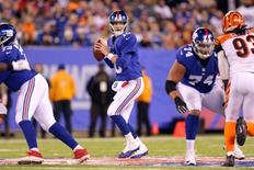 Nov 14, 2016; East Rutherford, NJ, USA; New York Giants quarterback Eli Manning (10) drops back to pass against the Cincinnati Bengals during the third quarter at MetLife Stadium. Mandatory Credit: Brad Penner-USA TODAY Sports