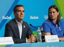 Aug 9, 2016; Rio de Janeiro, Brazil;  Los Angeles mayor Eric Garcetti and Angela Ruggiero during a LA2024 Los Angeles bid press conference during the Rio 2016 Summer Olympic Games at Olympic Gold Course. Mandatory Credit: Jerry Lai-USA TODAY Sports - RTSMZVP