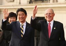 Japanese Prime Minister Shinzo Abe (L) and Peru's President Pedro Pablo Kuczynski wave as they meet at the presidential palace ahead of the 2016 APEC (Asia-Pacific Economic Cooperation) summit in Lima, Peru November 18, 2016. REUTERS/Mariana Bazo