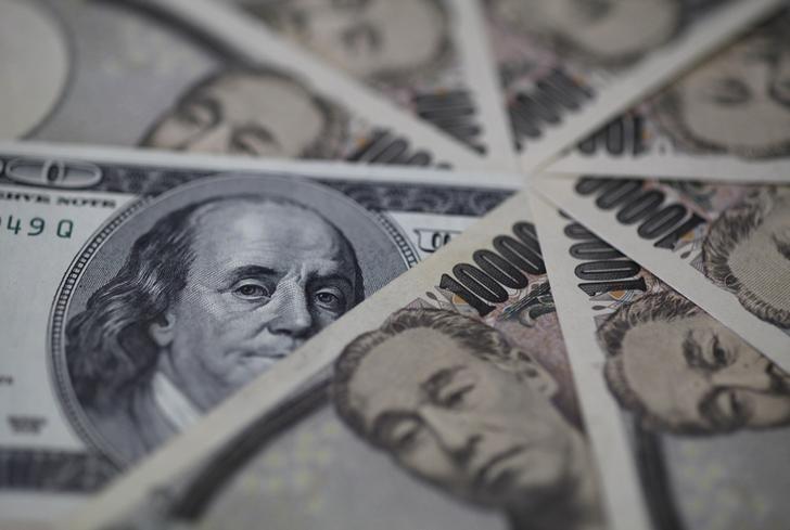 图为美元和日圆。REUTERS/Shohei Miyano