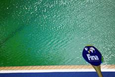 2016 Rio Olympics - Water Polo - Preliminary - Men's Preliminary Round - Group A Australia v Japan - Maria Lenk Aquatics Centre - Rio de Janeiro, Brazil - 10/08/2016. An International Swimming Federation (FINA) sign is seen in front of the Aquatics Centre pool where the water turned green. REUTERS/Kai Pfaffenbach