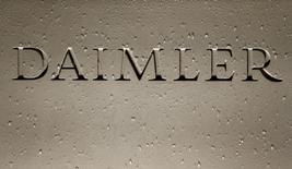 The Daimler AG sign with raindrops is pictured before the company's annual news conference in Stuttgart, Germany, February 4, 2016. REUTERS/Michaela Rehle/File Photo