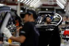 Workers put together doors for a locally assembled new BMW 7 Series on the production line at a Gaya Motor assembly plant in Jakarta, Indonesia November 30, 2016.   REUTERS/Darren Whiteside