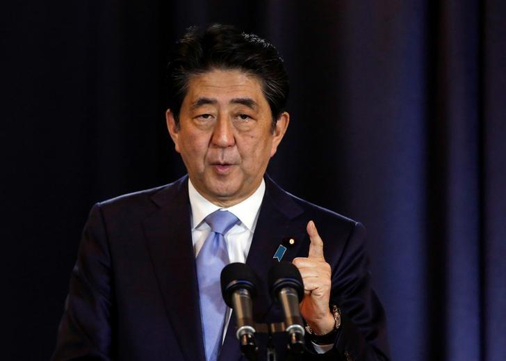 Japanese Prime Minister Shinzo Abe gestures during a press conference in Buenos Aires, Argentina, November 21, 2016. REUTERS/Agustin Marcarian