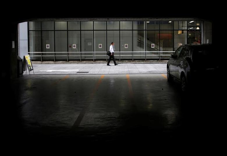 A man walks on a street in Tokyo, Japan, September 8, 2016. REUTERS/Issei Kato