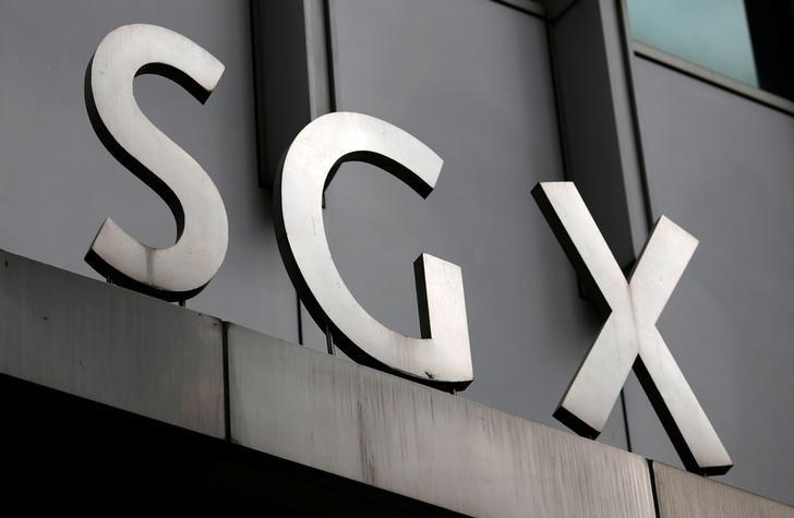 A logo of the Singapore Stock Exchange (SGX) is pictured outside its premises in the financial district of Singapore April 23, 2014.      REUTERS/Edgar Su/File Photo