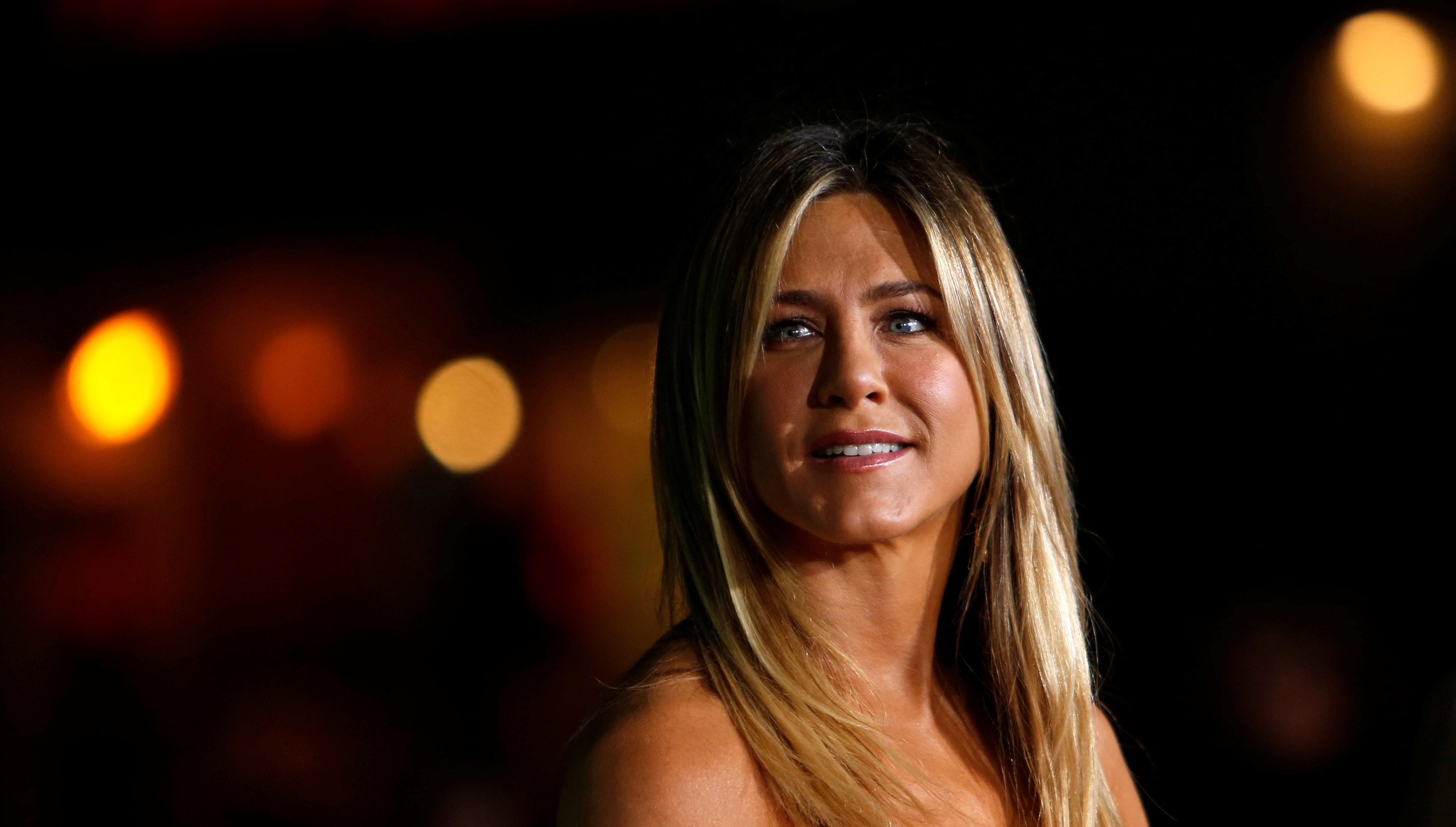Aniston faces unruly festivities in \