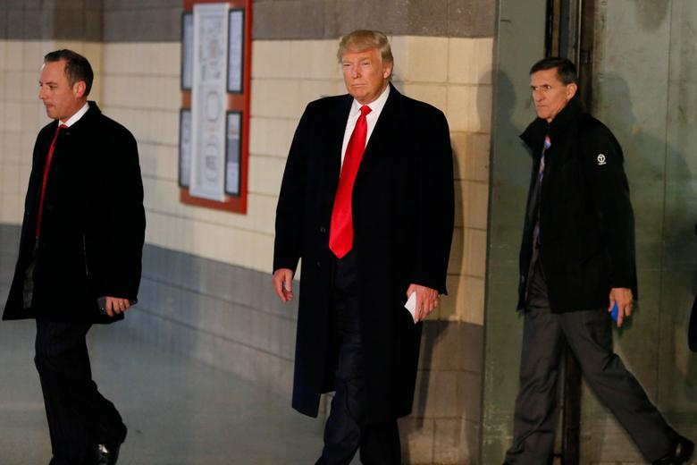 U.S. President-elect Donald Trump leaves an elevator with Reince Priebus (L) and retired U.S. Army Lieutenant General Michael Flynn before speaking with the media about meeting with families of the victims of the November 28 attacks at Ohio State University, in The Jerome Schottenstein Center in Columbus, Ohio, U.S., December 8, 2016. REUTERS/Shannon Stapleton