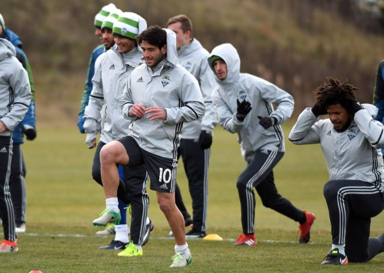 Dec 8, 2016; Toronto, Ontario, Canada;   Seattle Sounders midfielder Nicolas Lodeiro (10) and team mates do stretching drills prior to a training session in preparation for the MSL Cup Final at Kia Training Grounds. Mandatory Credit: Dan Hamilton-USA TODAY Sports