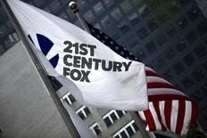 The flag of the Twenty-First Century Fox Inc is seen waving at the company headquarters in the Manhattan borough in New York June 11, 2015.  REUTERS/Eduardo Munoz/File Photo
