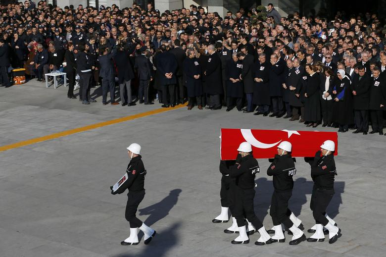 Turkish police officers carry a coffin of a fellow officer during a ceremony for police officers killed in Saturday's blasts in Istanbul, Turkey, December 11, 2016. REUTERS/Murad Sezer