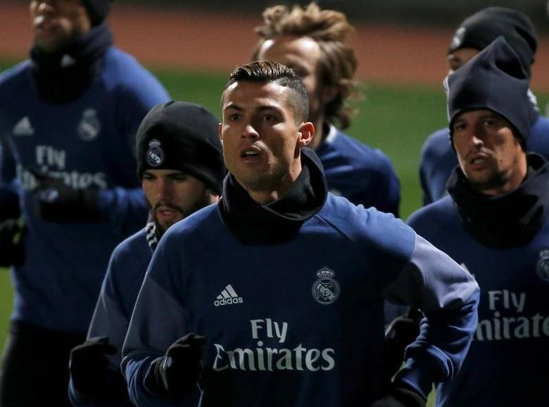 Football Soccer - Real Madrid training - FIFA Club World Cup - Yokohama, Japan - 12/12/16. Real Madrid's Cristiano Ronaldo and other players attend training ahead of FIFA Club World Cup Semi-Final match against Club America. REUTERS/Issei Kato