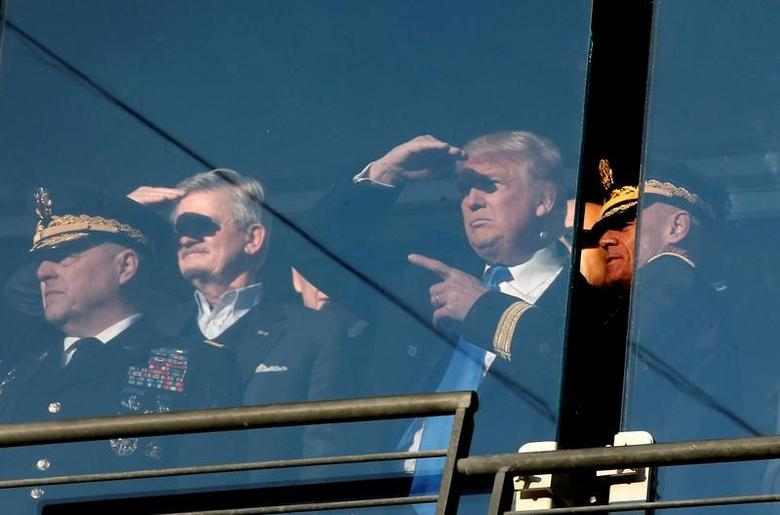 U.S. President-elect Donald Trump stands with General Mark A. Milley, Chief of Staff of the United States Army (L) and Lieutenant General Robert L. Caslen, Superintendent of the United States Military Accedemy at West Point (R) as he watches the Army vs Navy college football game at M&T Bank Stadium in Baltimore, Maryland, December 10, 2016.  REUTERS/Mike Segar
