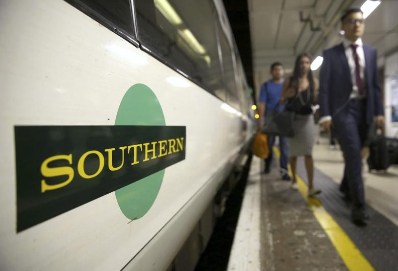 Passengers disembark a Southern train at Victoria Station in London, Britain August 8, 2016. REUTERS/Neil Hall/File Photo