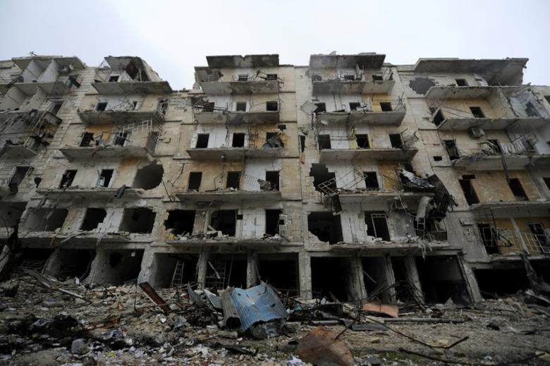 Damaged buildings are seen in the government-held al-Shaar neighborhood of Aleppo, during a media tour, Syria December 13, 2016. REUTERS/Omar Sanadiki