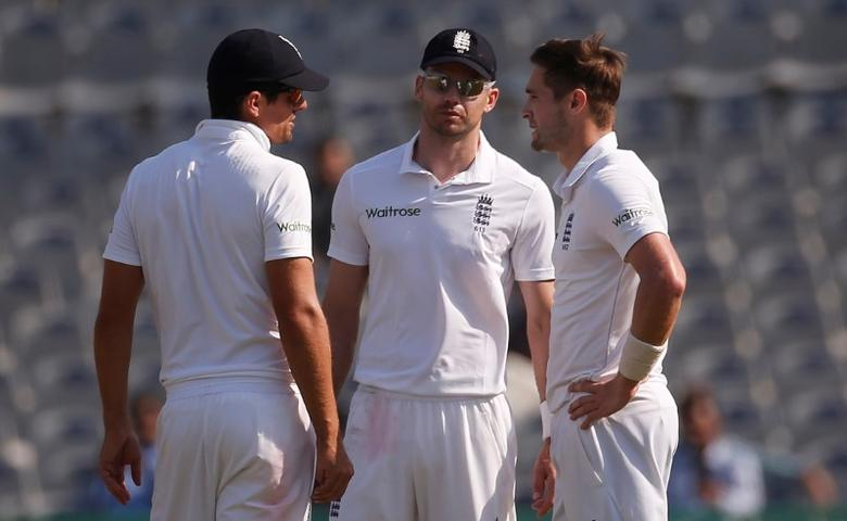 Cricket - India v England - Third Test cricket match - Punjab Cricket Association Stadium, Mohali, India - 28/11/16. England's captain Alastair Cook (L) speaks with his teammates James Anderson and Chris Woakes (R). REUTERS/Adnan Abidi