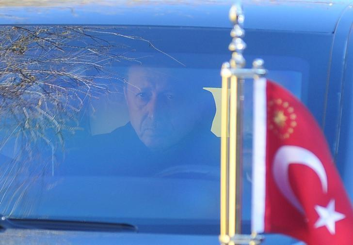 Turkish President Tayyip Erdogan leaves the police headquaters in his car after a ceremony for police officers who died in Saturday's blasts, in Istanbul, Turkey, December 11, 2016. REUTERS/Yagiz Karahan/Files